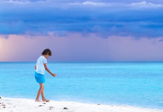 Little boy on a tropical beach at sunset Royalty Free Stock Photography