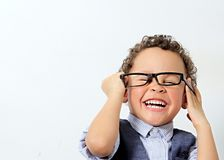 Free Little Boy Trying A Pair Of Glasses On Royalty Free Stock Image - 132964786