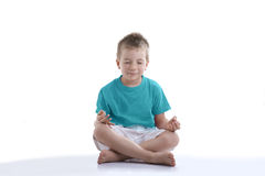 Little boy trying to concentrate for meditation royalty free stock photos