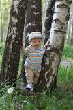 Little boy trying to walk by trees Stock Images