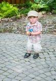 Little Boy Trzyma garście Kolorowi Wielkanocni jajka Zdjęcie Stock