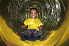 Little boy in tube slide Royalty Free Stock Image