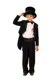 Little boy in a tuxedo and hat Stock Photo