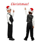 Little boy in a tuxedo and in Santa Claus xmas red Stock Photography