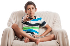Little boy tv remote control isolated white Stock Images