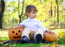 Little boy with two helloween pumpkins Stock Images