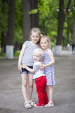 Little boy and two older cousins, meeting in the summer park Royalty Free Stock Photos