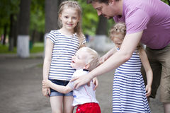 Little boy and two older cousins, meeting in the summer park royalty free stock images
