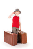 Little boy with two road suitcases. Stock Photos