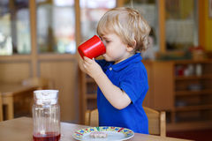 Little boy of two years having breakfast at nursery Stock Image