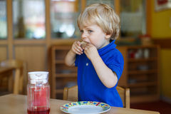 Little boy of two years having breakfast at nursery Royalty Free Stock Photography