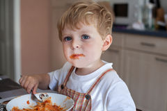 Little boy two years old eating pasta Stock Image