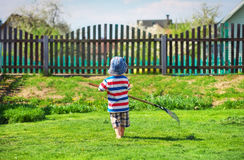 A little boy of about two years old in the garden. Royalty Free Stock Photography