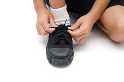 Little boy tying shoes close up isolated Stock Photography