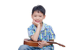 Little boy with ukulele Stock Image
