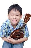 Little boy with ukulele Stock Photography