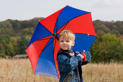 Little boy with umbrella. Little boy with his umbrella in autumn day Royalty Free Stock Image