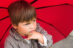 Little boy with the umbrella Stock Photos