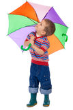 Little boy with umbrella, looking up Stock Photos