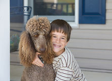 Little Boy und Hund Stockfoto