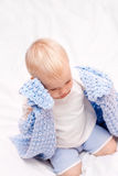 Little boy under blanket on the bed Royalty Free Stock Photos