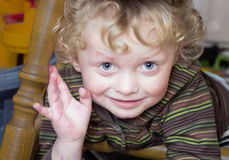 Little boy under a chair Stock Photography