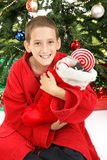 Little Boy Under Christmas Tree with Stocking. Cute little boy opening his Christmas stocking in front of the tree royalty free stock photography