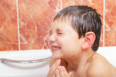 Little boy under shower Royalty Free Stock Photography
