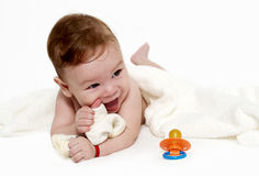 Little boy under a terry towel Royalty Free Stock Photos