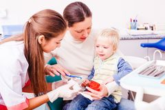 Visiting a dentist. Little boy is unhappy after unpleasant experience with dentist doctor. New meeteing with dentist, setting up a contact Stock Photos