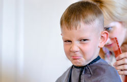 Little boy unimpressed with his haircut Stock Photos