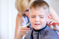 Little boy unimpressed with his haircut Stock Image