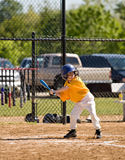 Little Boy Up to Bat. During a Game Stock Images