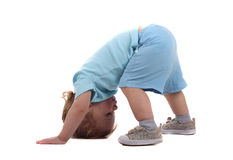 Little boy upside-down. A little boy on all fours isolated on the white royalty free stock images
