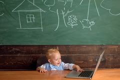 Little boy use free internet in computer class. Preschooler have access to wireless internet connection in school. Classroom royalty free stock image
