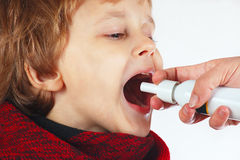 Little boy used medical spray for breath Stock Photo