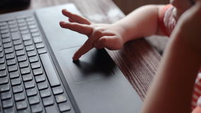 Little boy uses a laptop at home stock footage