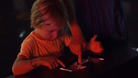 A little boy uses a tablet pc with an astronomical zodiac map. Children education concept. A little boy uses a tablet pc with an astronomical zodiac map stock footage