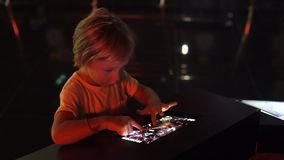 A little boy uses a tablet pc with an astronomical zodiac map. Children education concept. A little boy uses a tablet pc with an astronomical zodiac map stock video