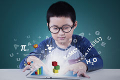 Little boy uses tablet for studying Royalty Free Stock Photography