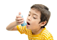 Little boy using Asthma inhaler for breathing Stock Photo