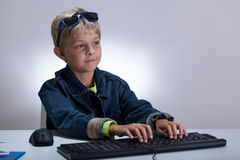 Little boy using computer Royalty Free Stock Images