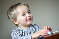 Little boy using a computer mouse Stock Photo