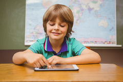 Little boy using digital tablet in classroom Stock Photography
