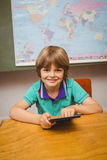Little boy using digital tablet in classroom Royalty Free Stock Photography