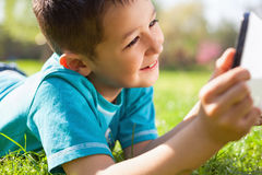 Little boy using digital tablet Stock Image