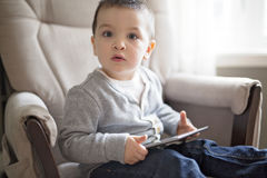 Little boy using a digital tablet sit on the living room Royalty Free Stock Photography