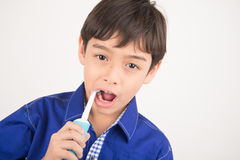 Little boy using electric toothbrushes dental healthcare on white background Stock Image
