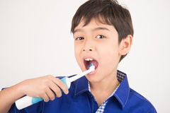 Little boy using electric toothbrushes dental healthcare on white background Stock Photo