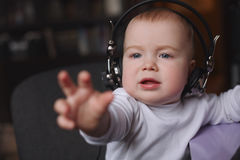 Little boy using headphones with mic Stock Photography